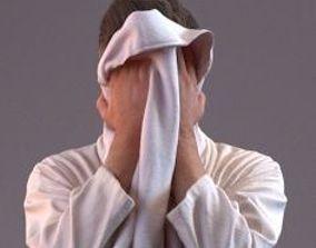3D Man in bathrobe drying his face