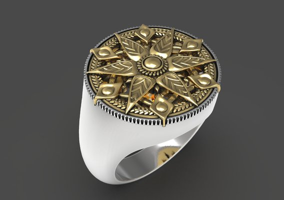 Ring with oriental ornament on top.