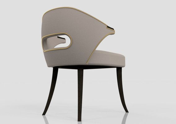Armchair with decorative head nails
